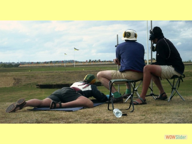 Peter Barry being coached by Ant Ringer and Peter Holden at 900 yards County Long Range, Bisley 2005.