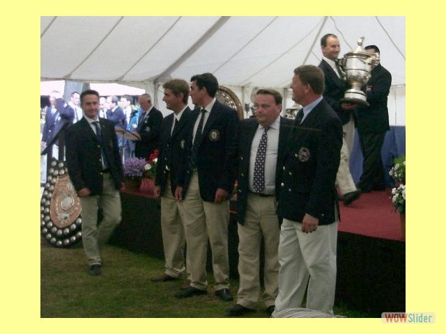 Glyn Barnett, Rich Stewart, Pete Holden, James Lewis, Nigel Ball and Guy Bartle collect the County Short from Mick Gault, Bisley 2005.
